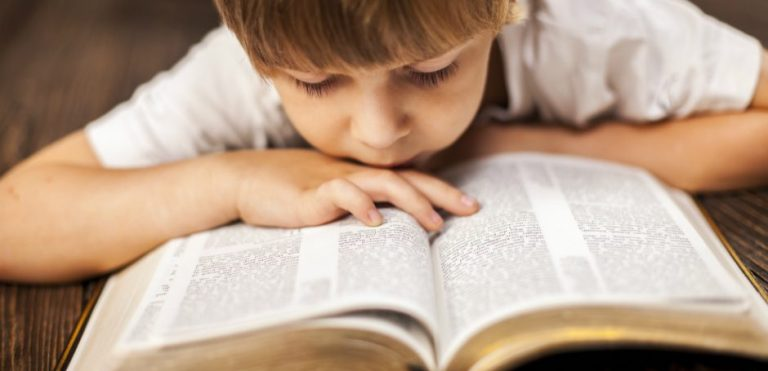 boy-reading-the-bible-940x455